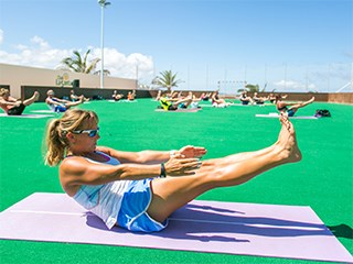 female doing hatha yoga at club la santa