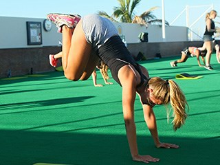 girl following the hiit bootcamp class